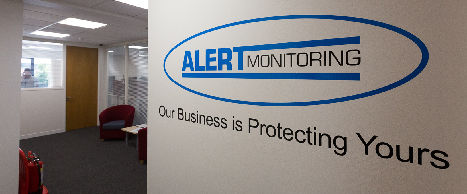 Alert Monitoring logo in office